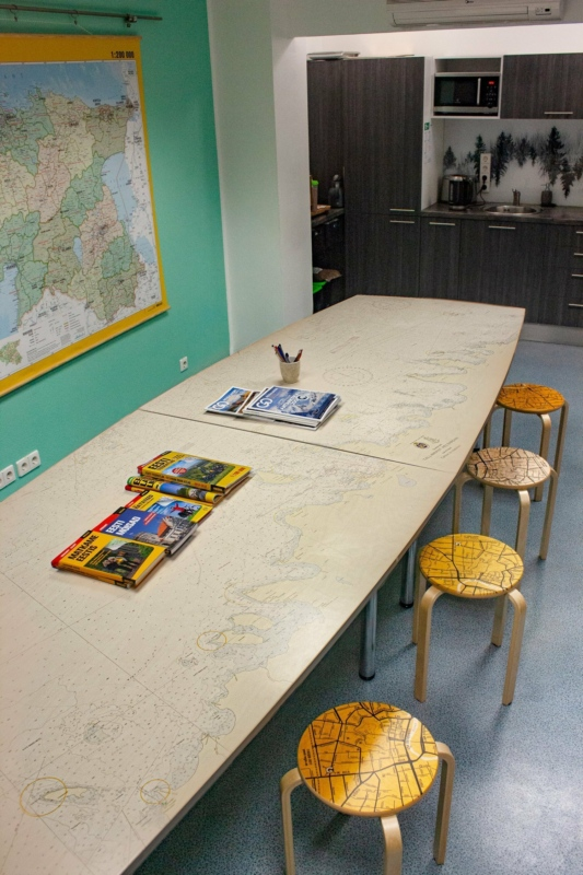 Sea map on wooden tabel at Regio office.
