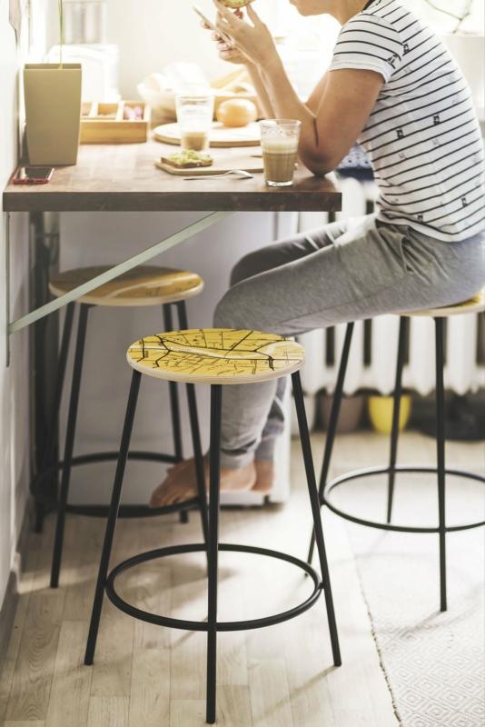 Wooden stool with metal legs. Photo: Hanna Maran