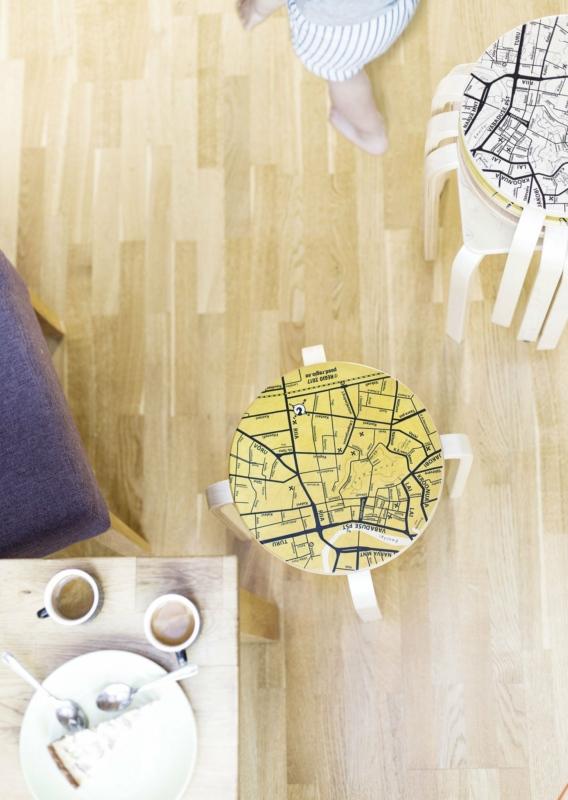 Wooden stools with city maps. Photo: Hanna Maran